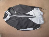 Men's Crivit Sports Soft Shell Jacket with full zip size and pocket Size XL with drawstring bottom