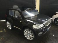 BMW ride on car in good condition with charger description as photo