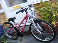"GIRLS 24"" WHEEL FRONT SUSPENSION BIKE HARDLY USED AGE 8+"