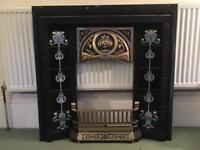 Cast iron fireplace with tiled inserts and brass inner