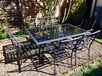 Black wought iron and glass garden dining table and 6 chairs