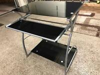 Black glass computer desk.