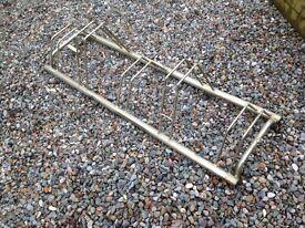 Floor mounted bike rack for garage or car port.
