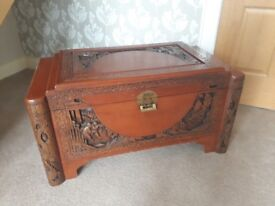 Oriental style carved wooden chest