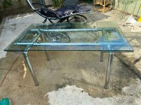 Glass and chrome extendable dining table