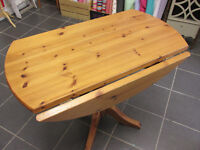 Drop leaf round pine dining table