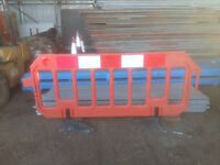 pedestrian barriers ( orange and red.)