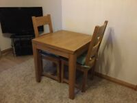 Solid oak kitchen table and two chairs