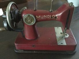Antique sewing machine with accessories