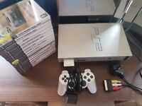 Silver Playstation 2 (ps2) and games
