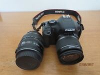 Canon EOS 550D with case, charger, 18-55 and 28-105 mm zoom lenses, lens and body caps, box.
