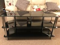 Glass tv stand in black and chrome