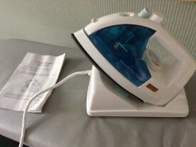 A Cordless Iron with its User Guide