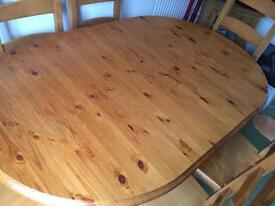 Solid pine extending dining table and six chairs