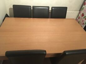 Table and 6 leather effect chairs