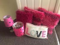Pink lamps and cushions