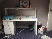 Large white solid desk with detachable shelving