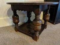Beautiful old round wooden table with unusual turned legs and solid base