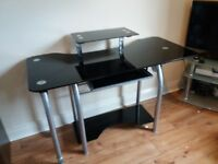 Glass computer table. Pull out table to extend working space .excellent condition