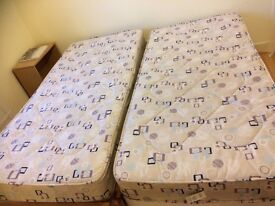 Two Single Beds With Almost New Mattresses