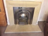 Contemporary Limestone Fireplace with Polished Cast Iron Insert