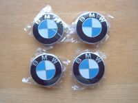 4 BMW ALLOY WHEEL CENTRES, NEW, UNUSED AND WRAPPED.