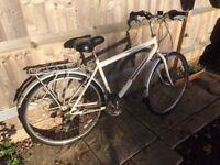 White large town bike with pannier rack