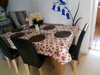 Large Argos dining table with 6 leather chairs