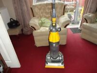 yellow and silver dyson dc 07 model working