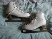 Riedell white ice skates size 4.5 feel free to come and try them on