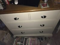 Cream drawers with oak top.