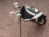 Golf clubs and bag and golf balls