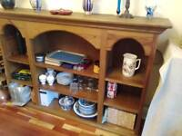 Large solid wood bookcase. 6 foot wide 4 foot tall. Very good quality.