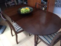 Extending highly polished dining table & 4 chairs - ideal for entertaining!!!