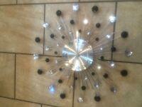 Retro style black and chrome Star Clock