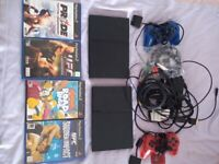2 x PS2, memory cards, control pads, 4 games - UFC/Pride/Simpsons