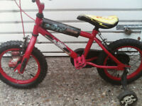 BOY OR GIRLE BIKE RED WITH STABLISERS 14 inch wheels £ 35 ovno