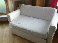 Ikea 2 seater sofa bed with white cover