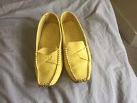 Bright yellow loafers by Tods. Size 36