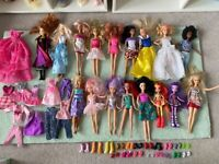 Barbie doll collection with extra clothes and shoes