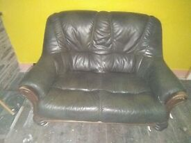 Pair of oak and leather 2 seat sofas