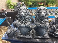 A pair of stone lionsgarden ornament 17 ins high