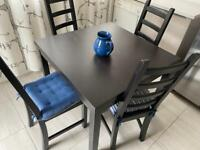 Black kitchen table set with 4 chairs
