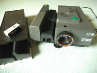 Slide projector with cartridges, spare bulb and case