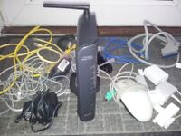 Belkin G wireless modem router and various wires/phone sockets, mouse.