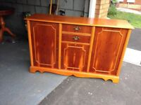 Yew wood dining table, 6 chairs and Sideboard
