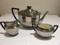 Silverine teapot, cream jug and sugar bowl