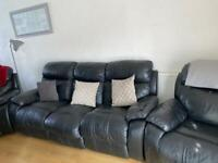 3 seater black leather reclining sofa and two chairs