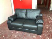 Faux leather black 2 seater sofa