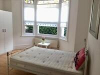 Fantastic large sunny double room with ensuite in a lovely house available now! Free WiFi!